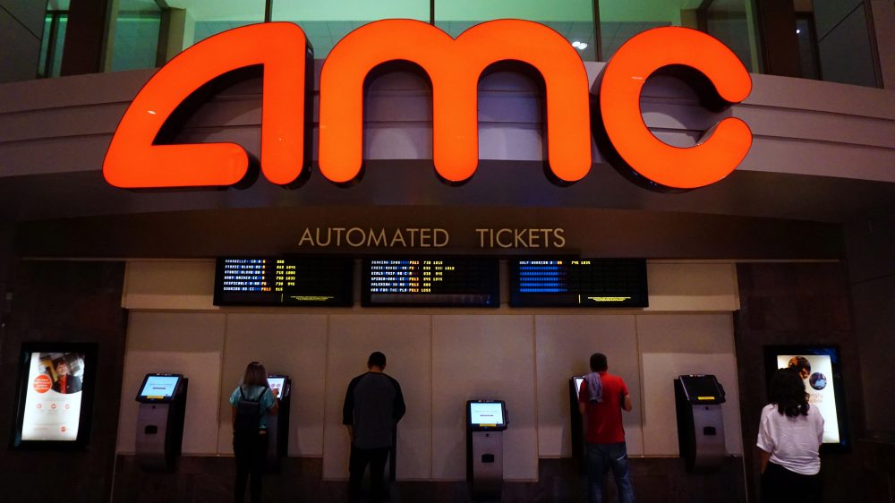 "Moviegoers purchase automated tickets at an AMC movie theater in Arcadia, Calif., on Aug. 2, 2017.  AMC Entertainment Holdings, the world's largest movie theater owner, announced a ""shocking"" expectation for secod-quarter losses, with stocks diving by 25 percent amid a weak box office. (Frederic J. Brown/AFP/Getty Images)"