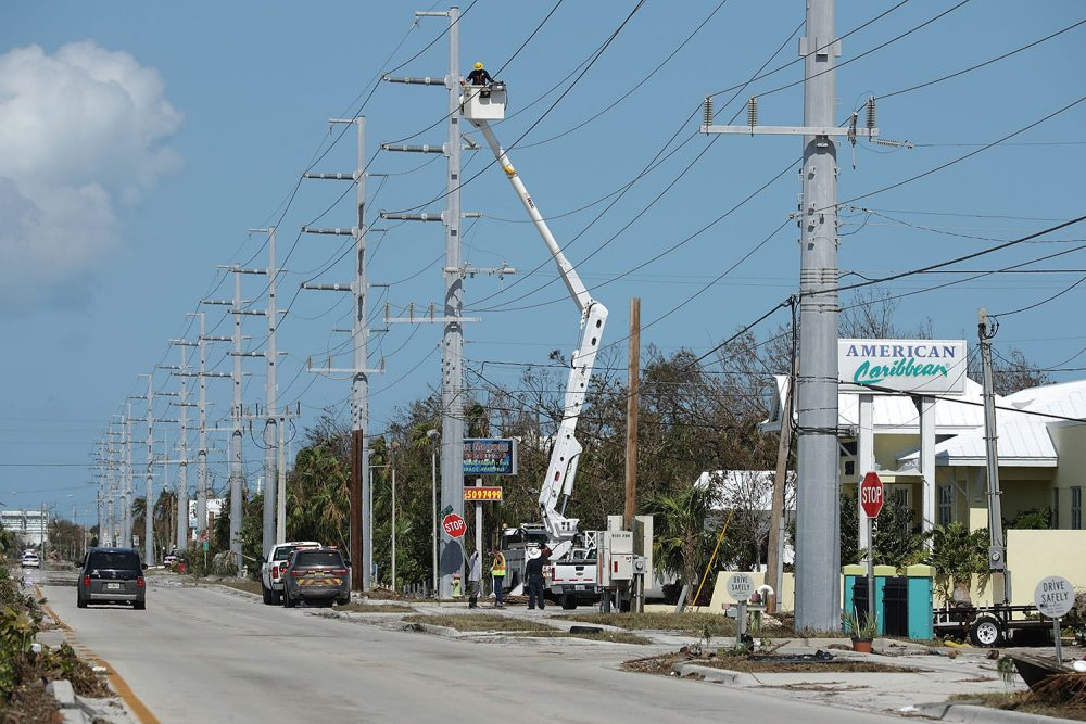Utility workers repair high-voltage power lines across from the Florida Keys Marathon International Airport Sept. 12, 2017 in Marathon, Fla. (Chip Somodevilla/Getty Images)