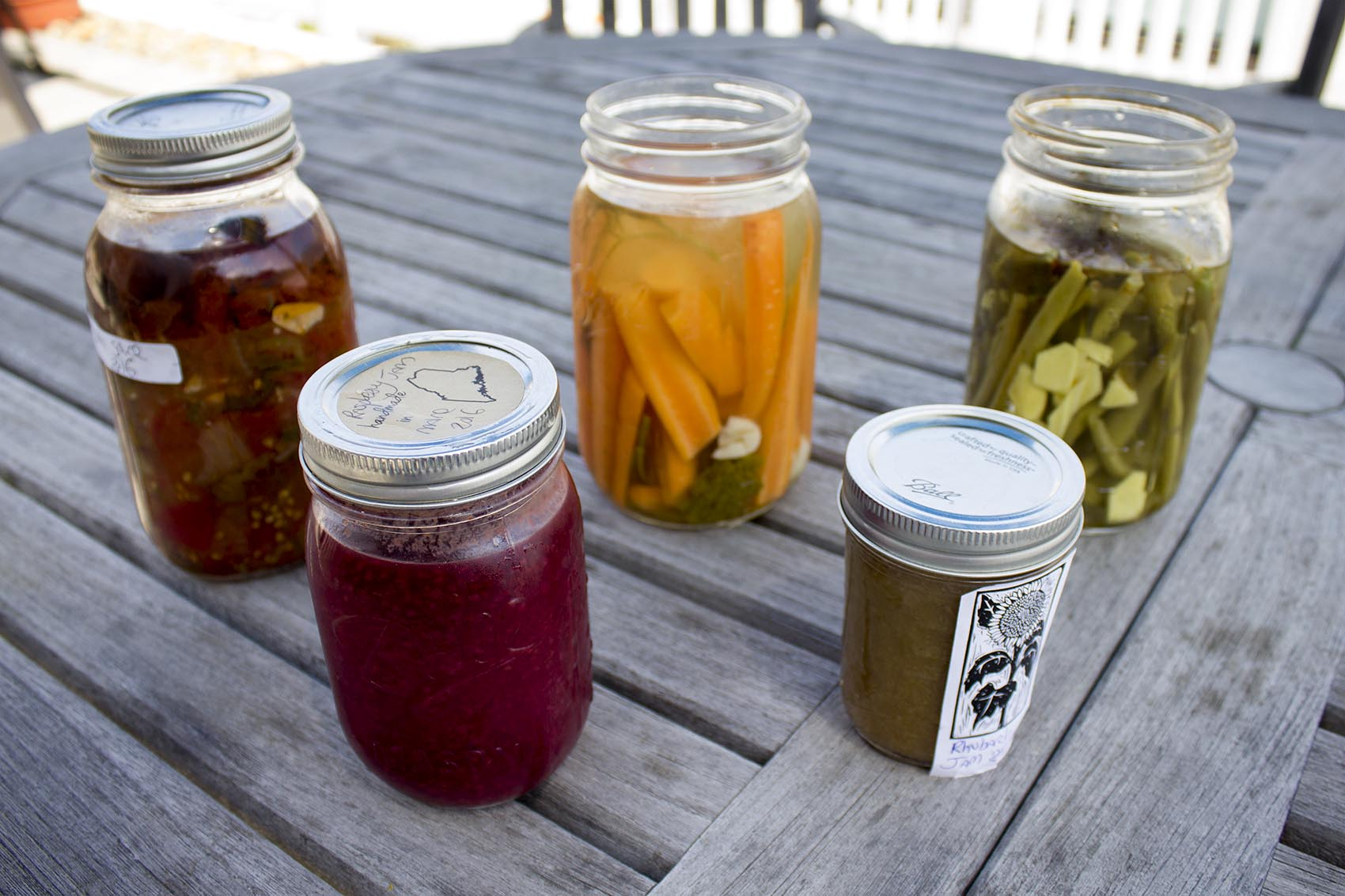 The idea behind canning is to preserve the very freshest, ripest summer foods — be it seasonal fruit, vegetables or edible flowers — before they begin to decay. (Jackson Mitchell/Here & Now)