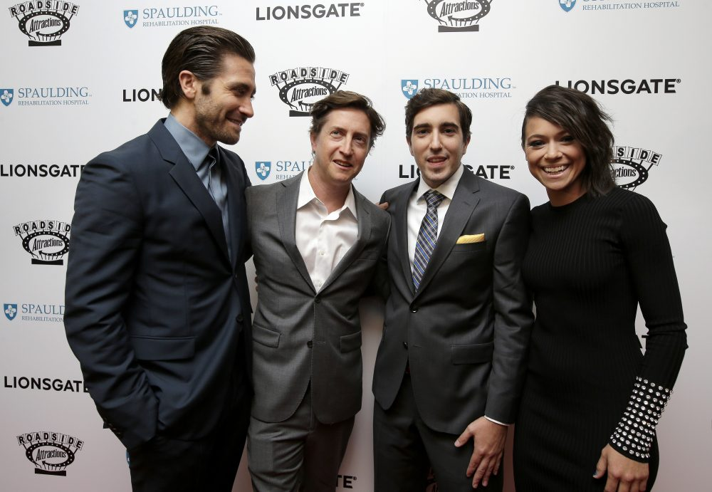 "Actor Jake Gyllenhaal, left, director David Gordon Green, center left, Boston Marathon bombing survivor Jeff Bauman, center right, and actress Tatiana Maslany, right, arrive on the red carpet on Tuesday at the U.S. premiere of the movie ""Stronger"" at the Spaulding Rehabilitation Hospital in Boston. (Steven Senne/AP)"