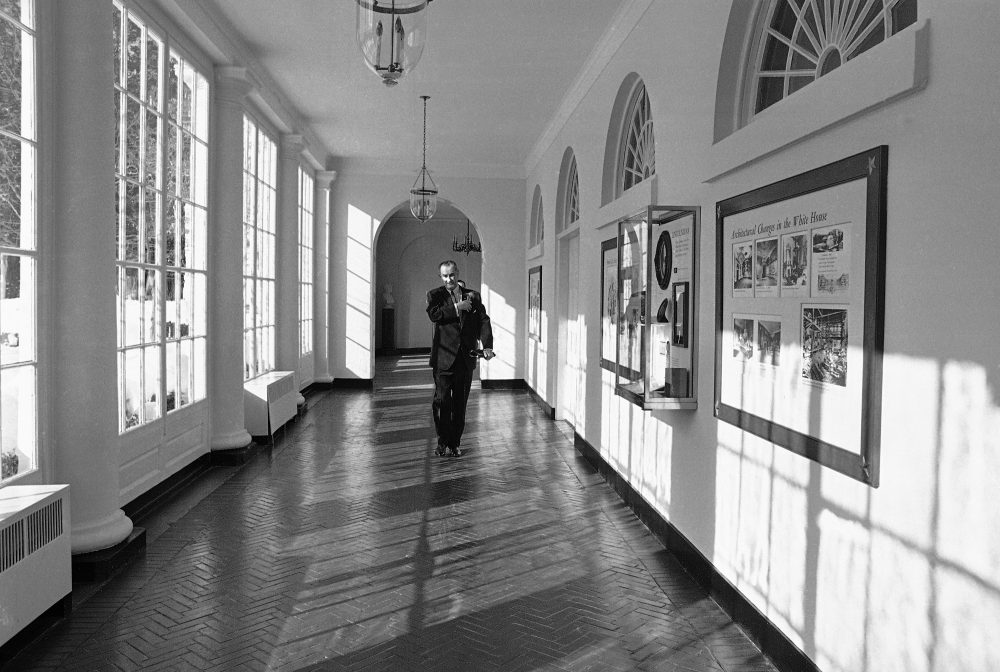 President Lyndon Johnson walks down a White House corridor on his way to tell the nation and the world of the decision to resume bombing of North Vietnam, Jan. 31, 1966. In February 1966, Johnson traveled to Hawaii to meet Vietnamese leaders Nguyen Cao Ky and Nguyen van Thieu. Historians Brian Balogh and Nathan Connolly say it was an attempt to draw attention away from the start of Sen. J. William Fulbright's (D-Ark.) Vietnam hearings, which threatened Johnson's agenda. (AP)