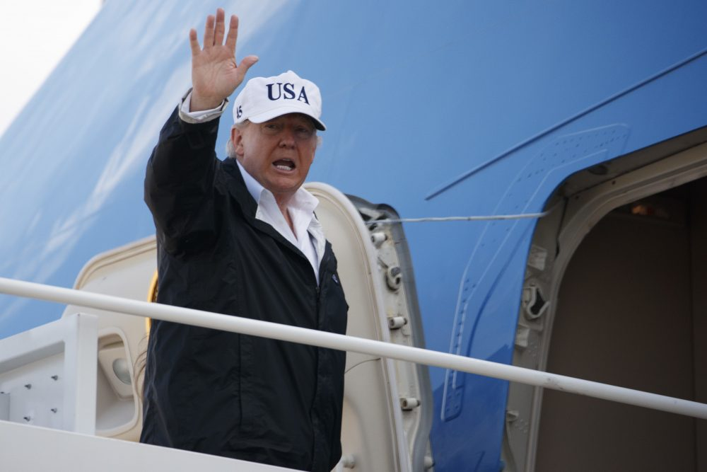 President Trump waves as he boards Air Force One for a trip to Florida to meet with first responders and people impacted by Hurricane Irma, Thursday, Sept. 14, 2017, in Andrews Air Force Base, Md. (Evan Vucci/AP)