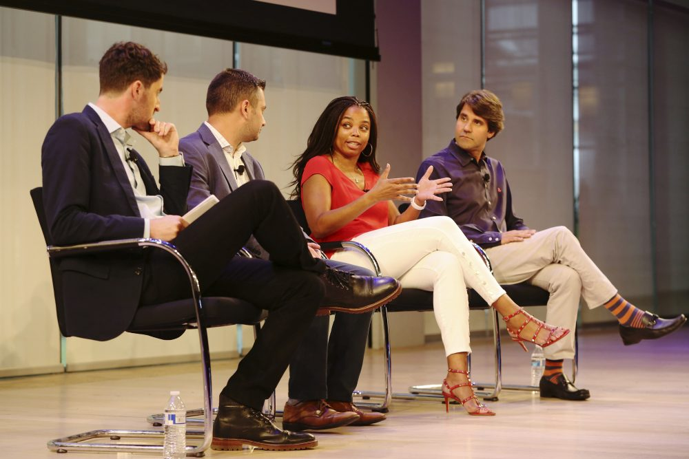 Jemele Hill, anchor on ESPN's SportsCenter, speaks on stage with Michael Shiffman, Nate Ravitz, and Daniel Roberts at a 2017 sports conference. (Steve Luciano/AP Images)