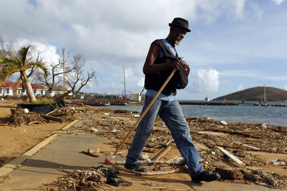 A man walks past debris caused by Hurricane Irma in Charlotte Amalie, St. Thomas, U.S. Virgin Islands, Sunday, Sept. 10, 2017. The storm ravaged such lush resort islands as St. Martin, St. Barts, St. Thomas, Barbuda and Anguilla. (Ricardo Arduengo/AP)