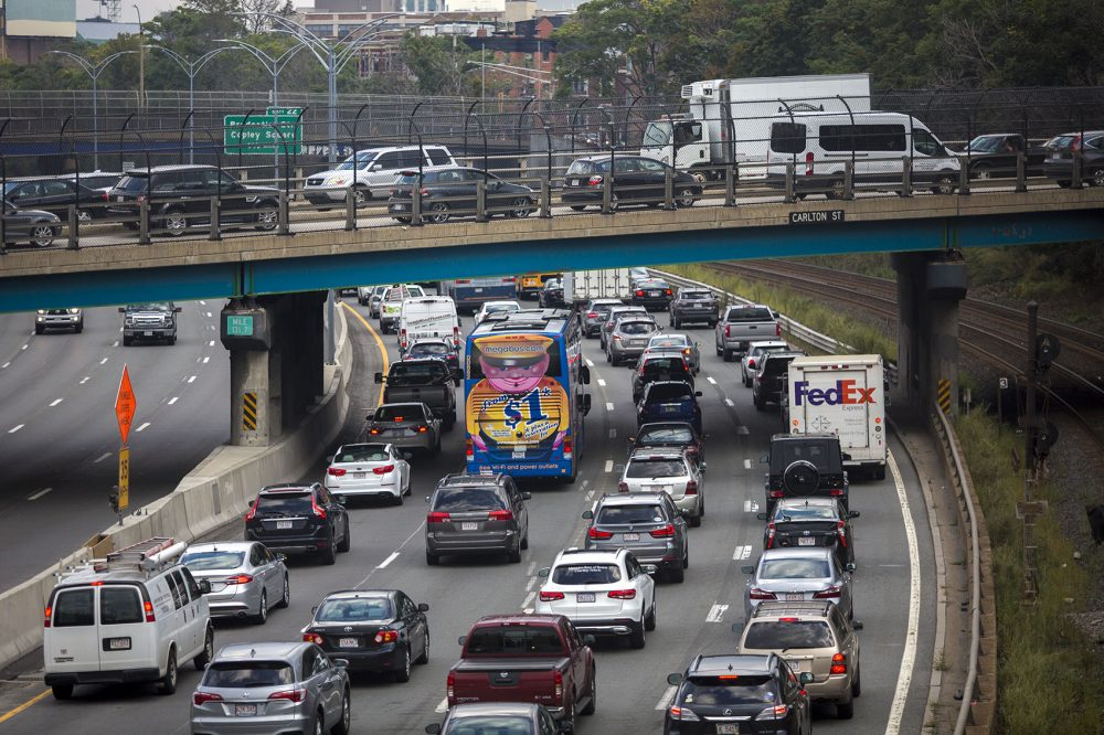 The Friday evening commute begins as cars jam up on the Mass Pike and on the overpass on Carlton Street in Brookline. (Jesse Costa/WBUR)