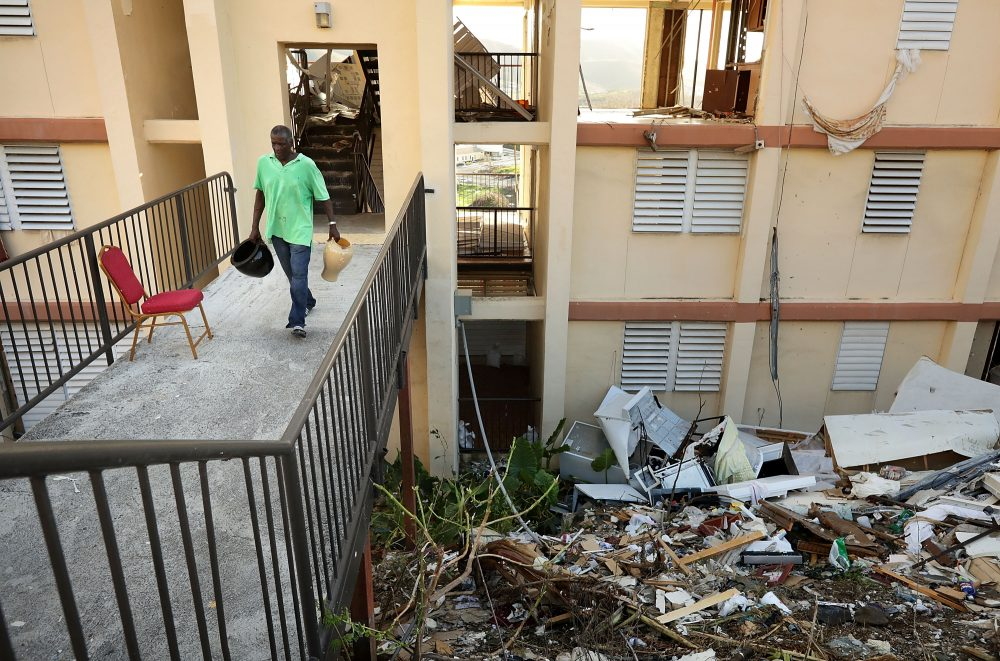 Wentworth Drew carries valuables out of his apartment at the Tutu High Rise after looters broke in after Hurricane Irma destroyed the building, Sept. 17, 2017 in Charlotte Amalie, St Thomas, U.S. Virgin Islands. (Chip Somodevilla/Getty Images)