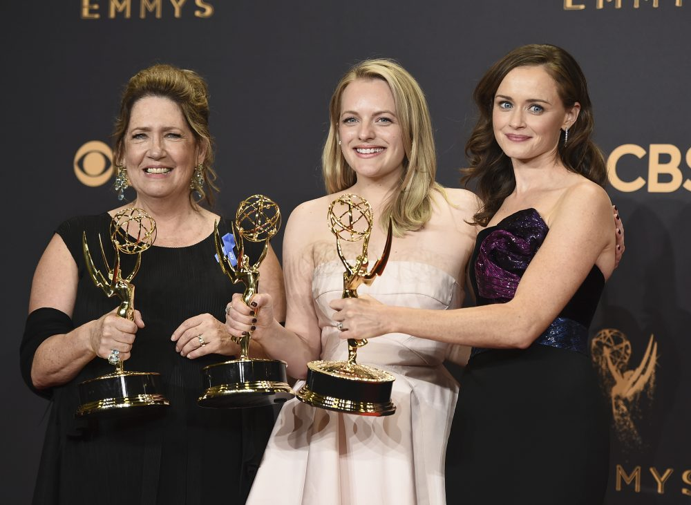 "Ann Dowd, from left, winner of outstanding supporting actress in a drama series, Elisabeth Moss, winner of outstanding lead actress in a drama series, and Alexis Bledel, winner of outstanding guest actress in a drama for ""The Handmaid's Tale"" pose in the press room at the 69th Primetime Emmy Awards on Sunday, Sept. 17, 2017, at the Microsoft Theater in Los Angeles. (Jordan Strauss/Invision/AP)"