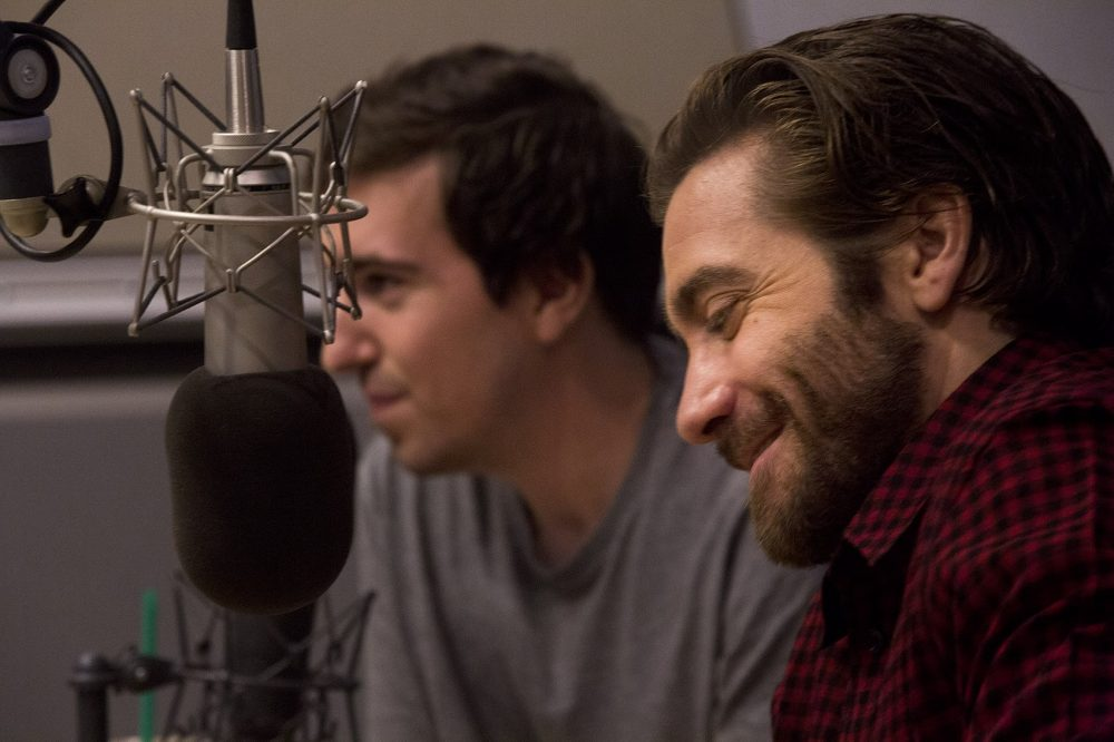 Jake Gyllenhaal, front, and Jeff Bauman in the WBUR studio during an interview on Here & Now. (Jesse Costa/WBUR)