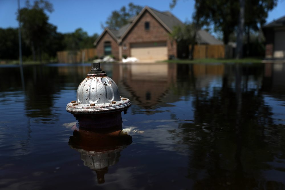 The top of a fire hydrant sticks out of floodwaters in front of a home on Sept. 7, 2017, in Richwood, Texas, in the aftermath of Harvey. (Justin Sullivan/Getty Images)