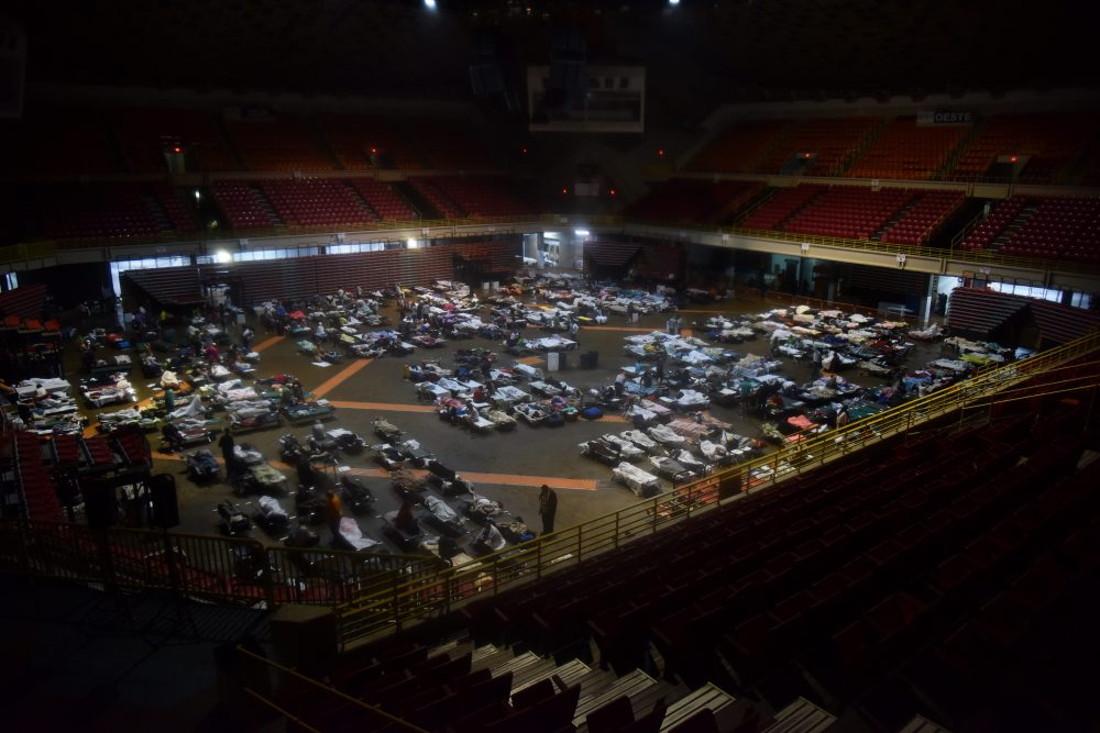 Residents seek shelter inside Roberto Clemente Coliseum in San Juan, Puerto Rico, early on Sept. 20, 2017, as Hurricane Maria passes the island. (Hector Retamal/AFP/Getty Images)