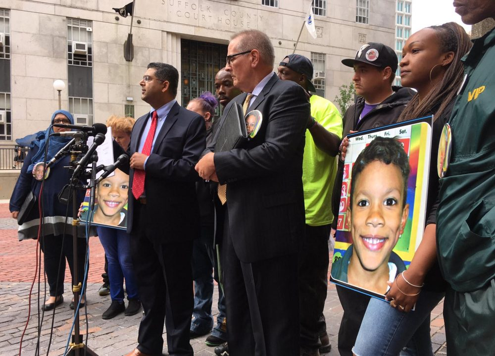 The family of Kyzr Willis stands with lawyers during a press conference in September 2017. The family announced they have settled a lawsuit with the city of Boston in the little boy's death. (Steve Brown/WBUR)