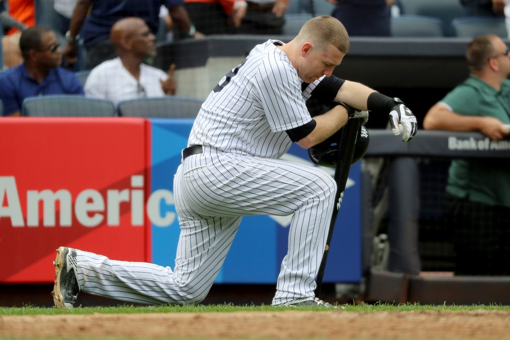 Todd Frazier of the New York Yankees reacts after a child was hit by a foul ball off his bat in the fifth inning against the Minnesota Twins on Sept. 20, 2017 at Yankee Stadium in the Bronx borough of New York City.  (Abbie Parr/Getty Images)