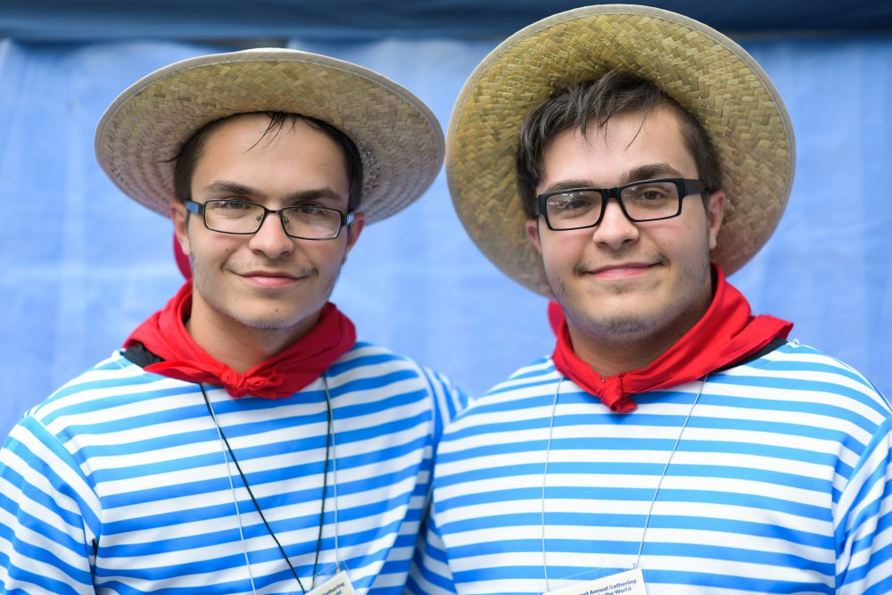 Samuel Muscatto, left, and identical twin brother Joseph, both 18 from Buffalo, pose for a portrait during the Twins Days Festival in Twinsburg, Ohio, on Aug. 5, 2017. (Dustin Franz/AFP/Getty Images)