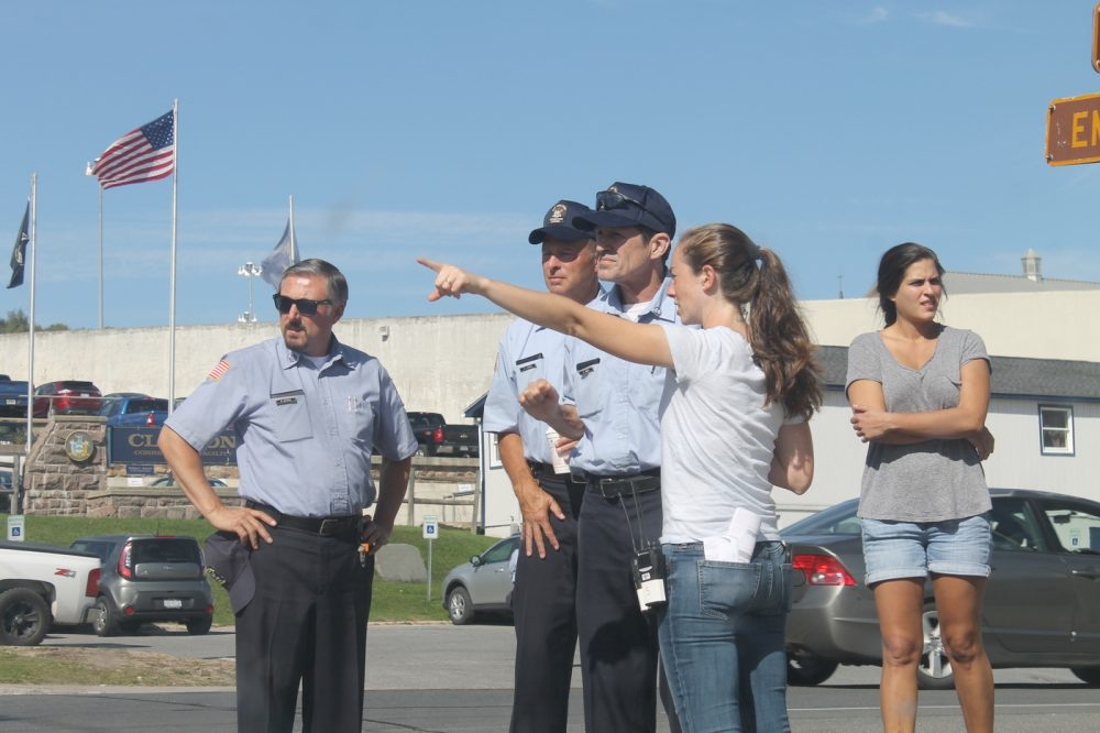Actors playing corrections officers get instructions from a member of Ben Stiller's production crew on Wednesday. (Zach Hirsch/North Country Public Radio)