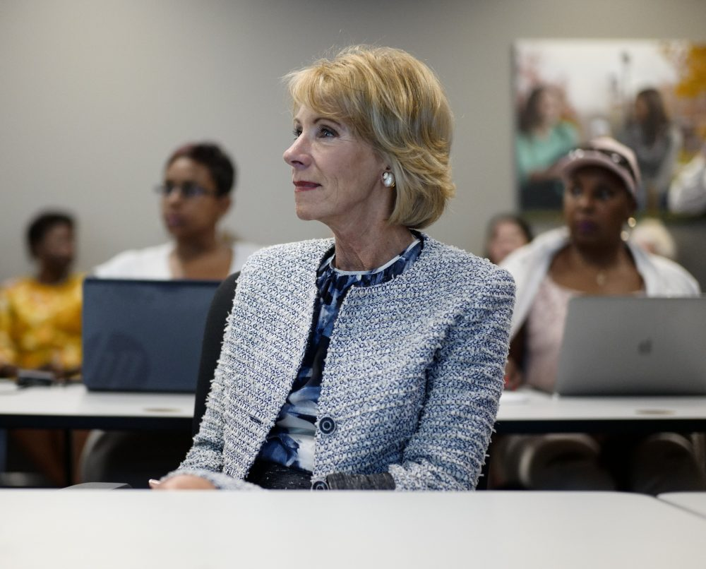 "US Education Sect. Betsy DeVos sits in on a coding class in Omaha, Neb., Wednesday, Sept. 13, 2017, during a visit to the Midland University-Omaha Campus for her 2017 ""Rethink School"" tour, in which she will visit schools in Wyoming, Colorado, Nebraska and Kansas. (AP Photo/Nati Harnik)"