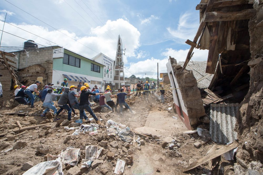 Soldiers and volunteers knock down the walls of a damaged house in Joquicingo, Mexico, on Sept. 21, 2017.  Time pressed on Mexico on Thursday as rescuers looking for survivors picked through the rubble of buildings felled by a powerful earthquake two days earlier, with hopes fading as the hours rolled by. (Mario Vazquez/AFP/Getty Images)