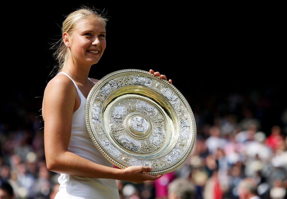 Maria Sharapova poses with the Wimbledon trophy after defeating Serena Williams in the 2004 final. (Mike Hewitt/Getty Images)