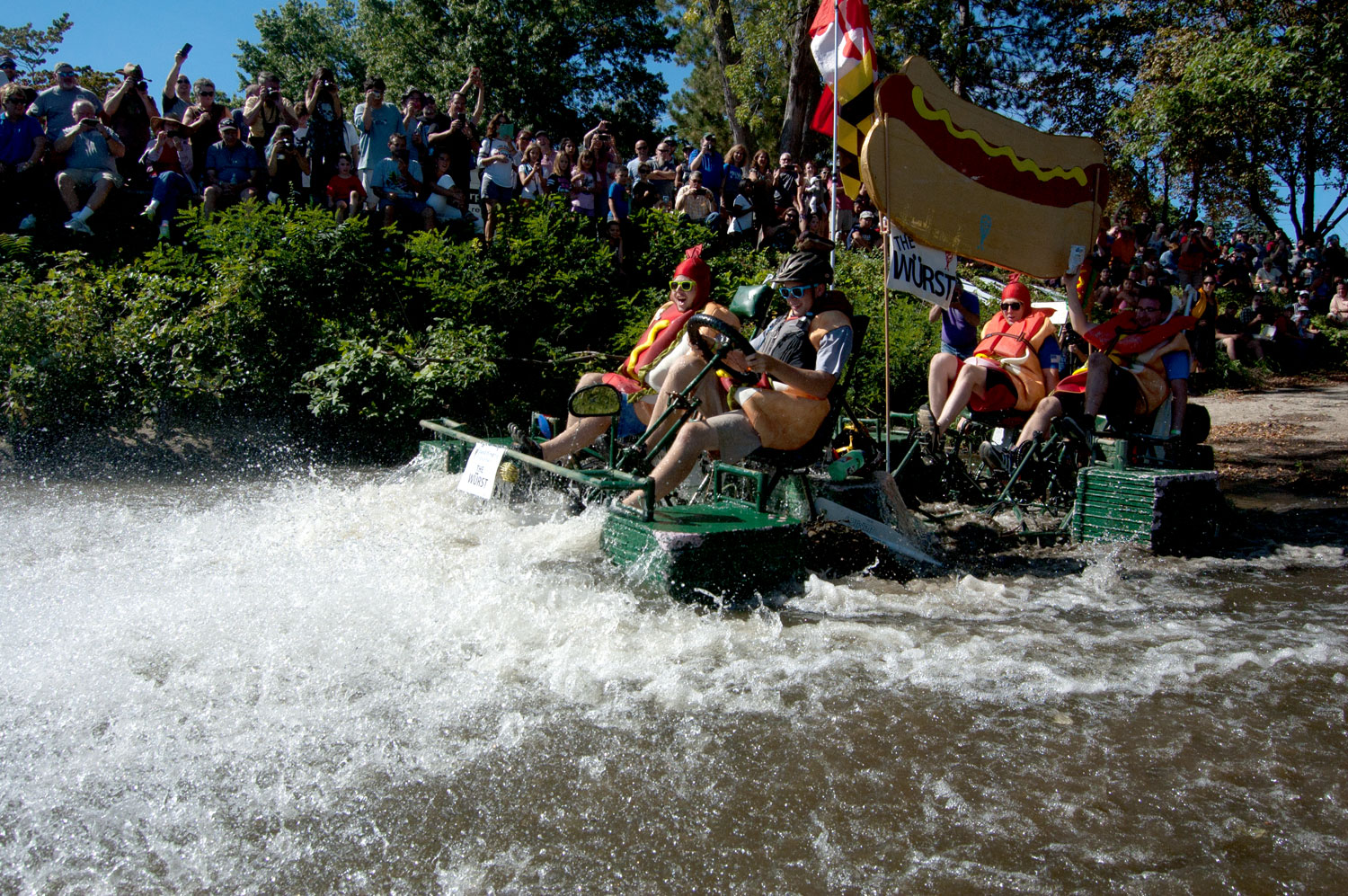 """The Wurst"" by students from Jemicy High School in Maryland splashes into the Merrimack River. (Greg Cook/WBUR)"