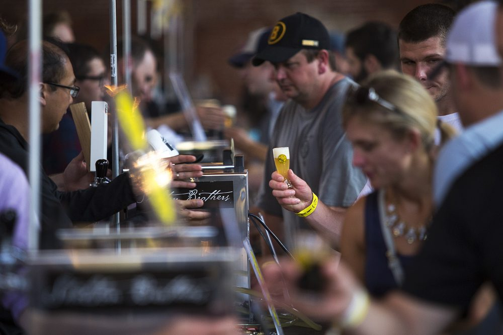 Festival goers lined up to sample beer from over 50 brewers from around the world. (Jesse Costa/WBUR)