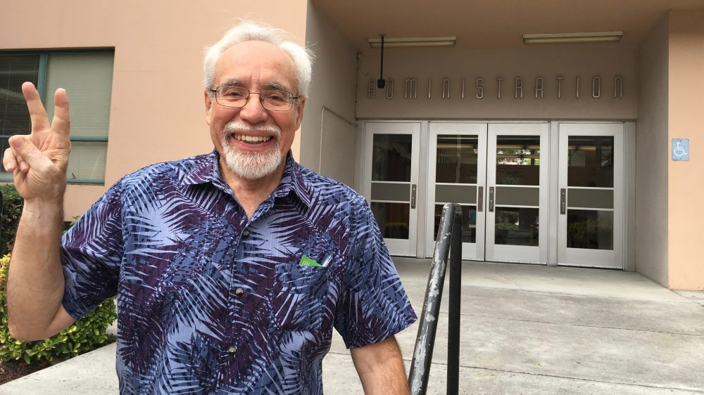 Gil Villagran stands in front of the administration building at San Jose State University. He now teaches at the School of Social Work, but was expelled in the 1960s after participating in an anti-war protest. (Rachael Myrow/KQED)
