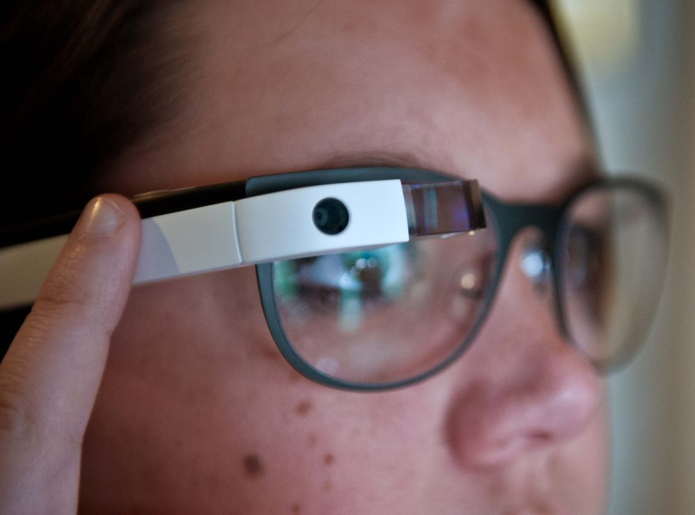 Allyson Cannon, recruitment manager of the National Press Club, uses her finger to scroll through pictures as she tries Google Glass at the National Press Club in Washington on April 4, 2014. (Nicholas Kamm/AFP PHOTO/Getty Images)