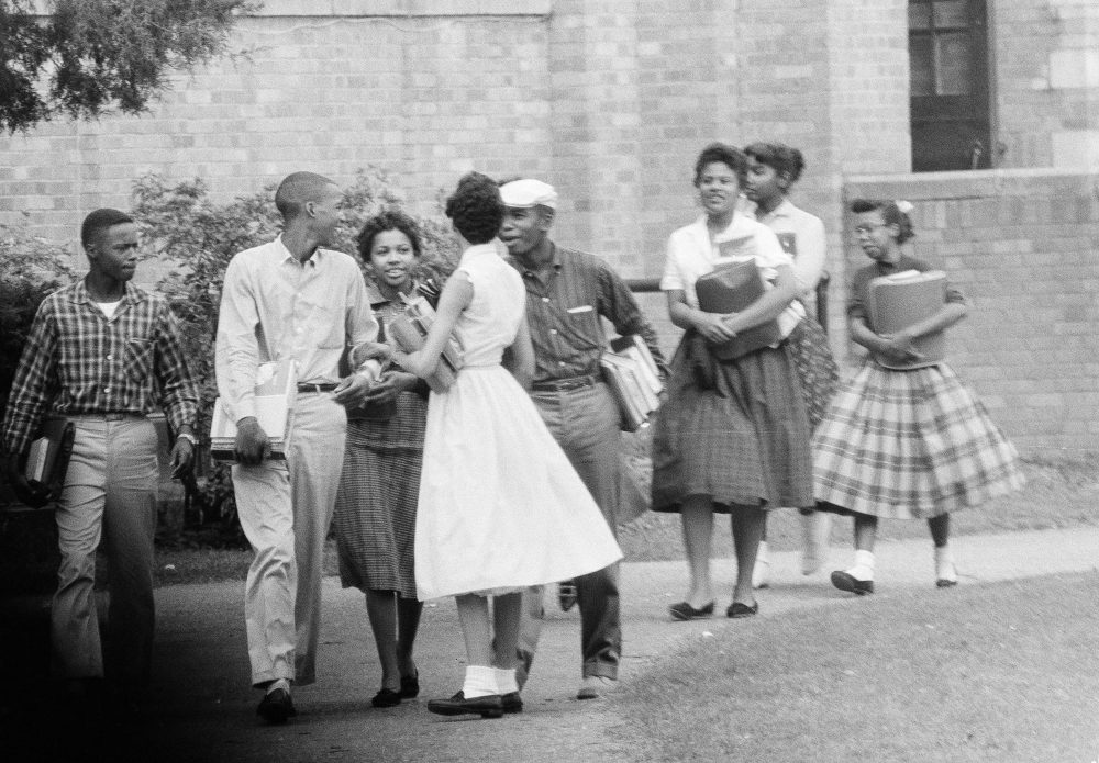 Eight of the nine black students attending Central High School in Little Rock, Ark., are shown as they walked from school to their waiting Army station wagon, Oct. 2, 1957. (Ferd Kaufman/AP)