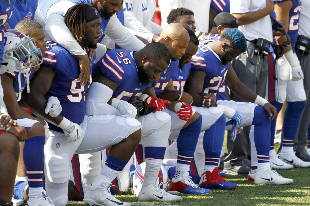 Buffalo Bills players kneel during the national anthem prior to an NFL football game against the Denver Broncos, Sunday, Sept. 24, 2017, in Orchard Park, N.Y. (Jeffrey T. Barnes/AP)