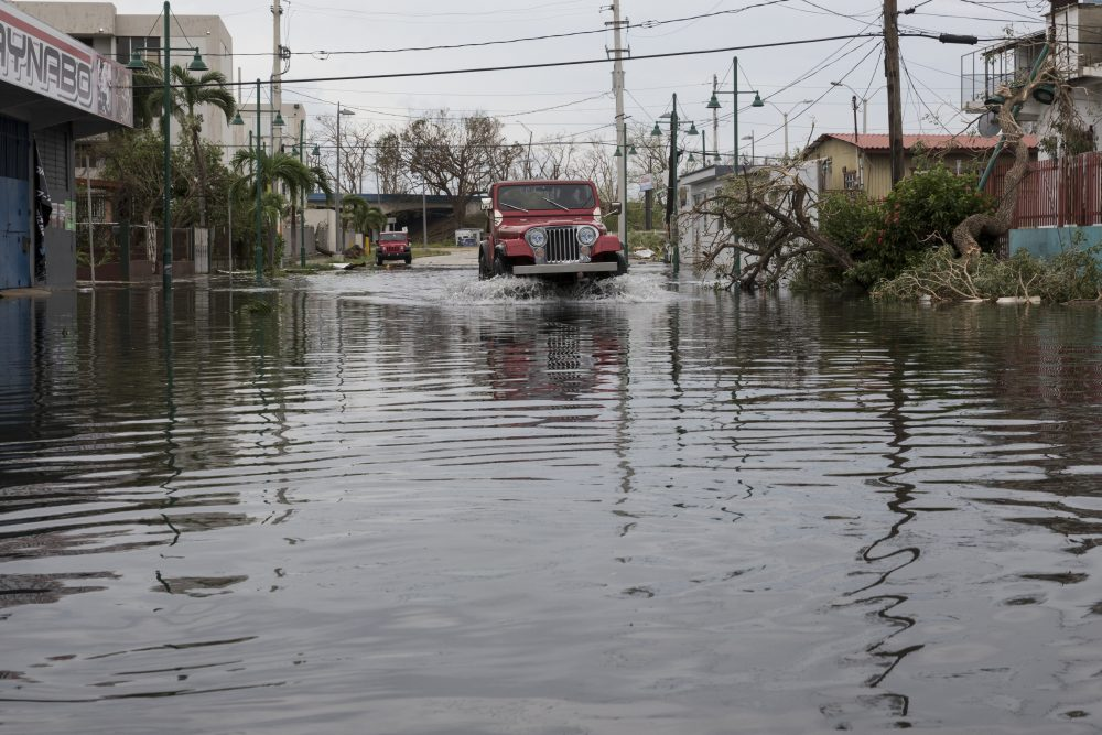 Streets in the Guaynabo suburb are flooded after Hurricane Maria made landfall, Sept. 21, 2017, in San Juan, Puerto Rico. The majority of the island has lost power, in San Juan many have been left without running water or cellphone service. (Alex Wroblewski/Getty Images)