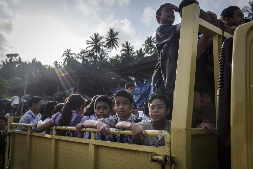 Evacuee children on a truck as they head off to a temporary school on Sept. 27, 2017 in Karangasem regency, Bali, Indonesia. Indonesian authorities declared a state of emergency as hundreds of tremors are recorded at Bali's Mount Agung volcano, and around 90,000 villagers evacuated their homes. Authorities issued travel warnings for the popular tourist destination and warned Mount Agung has the potential to erupt imminently although flights to Bali and its main tourist areas remain unaffected for now. (Ulet Ifansasti/Getty Images)