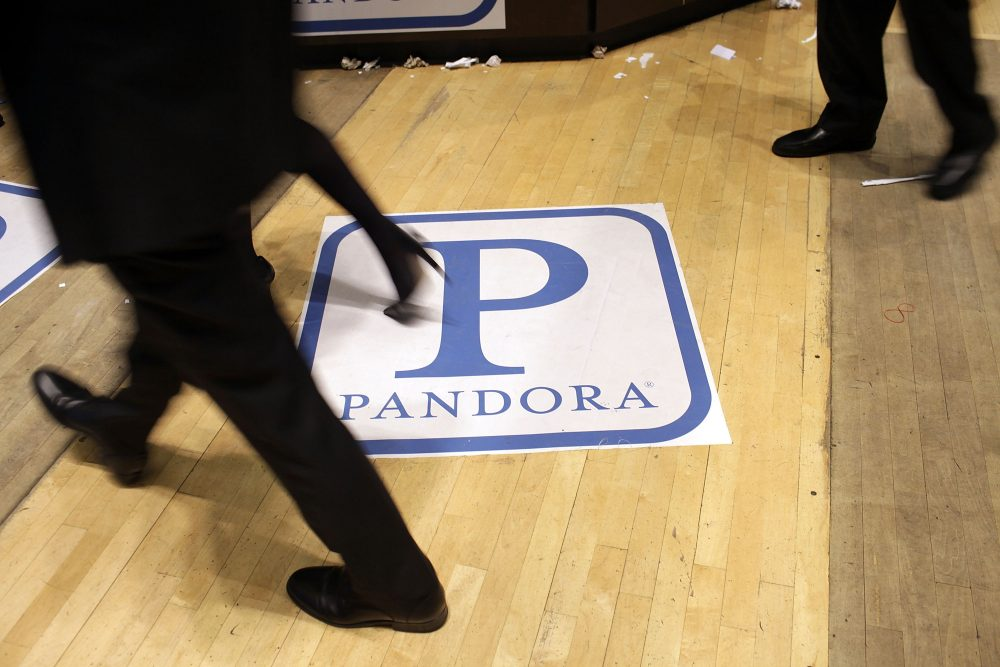Traders on the floor of the New York Stock Exchange walk over insignia for Pandora Media Inc., the online-radio company, on its first day of trading as a public company on June 15, 2011 in New York City. (Spencer Platt/Getty Images)