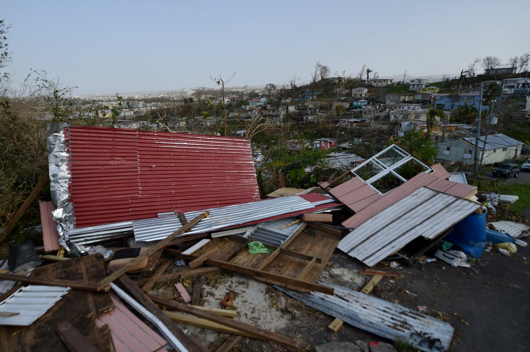 Destroyed homes are seen following the passage of Hurricane Maria in the neigborhood of Acerolas in Toa Alto, Puerto Rico, on Sept. 26, 2017. (Hector Retamal/AFP/Getty Images)