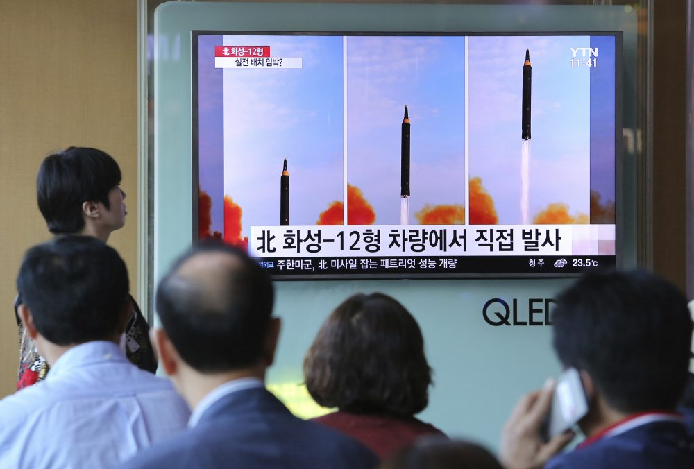 People watch a TV screen showing a local news program reporting about North Korea's missile launch, at the Seoul Railway Station in Seoul, South Korea, Saturday, Sept. 16, 2017. (Ahn Young-joon/AP)