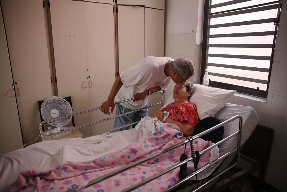 Rafael Robles-Ortiz kisses his mother Josefina Ortiz, who is staying at the Hermanitas de los Ancianos Desamparados facility, which cares for the elderly, as they deal with the aftermath of Hurricane Maria, on Sept. 26, 2017 in San Juan, Puerto Rico. (Joe Raedle/Getty Images)