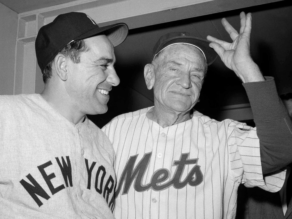 Casey Stengel, right, played in the majors for 14 years and managed for another 25. (Marty Lederhandler/AP)