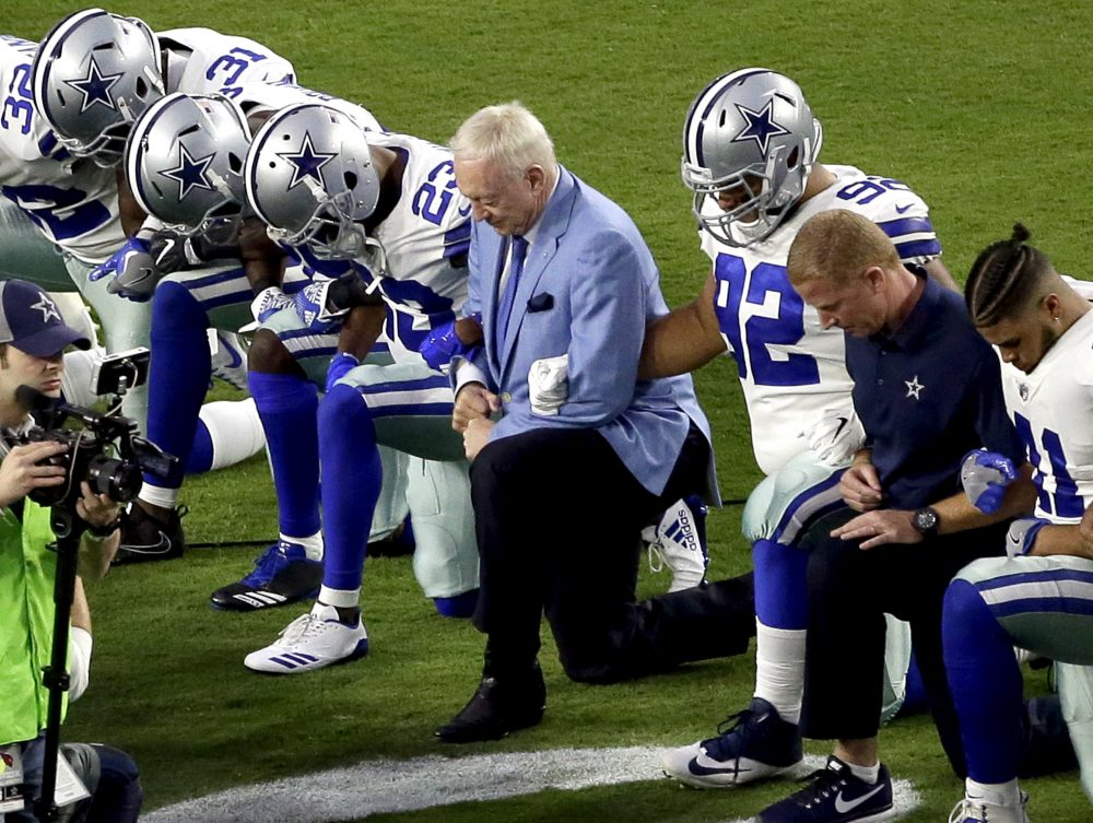 Should we be surprised that NFL owners like Jerry Jones (center) have supported players following President Trump's comments about the NFL? (Matt York/AP)