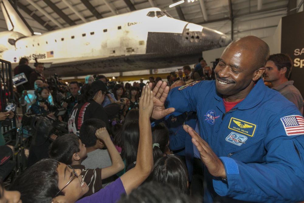 Leland Melvin greets school children at the California Science Center in Los Angeles in 2012. (Damian Dovarganes/AP)