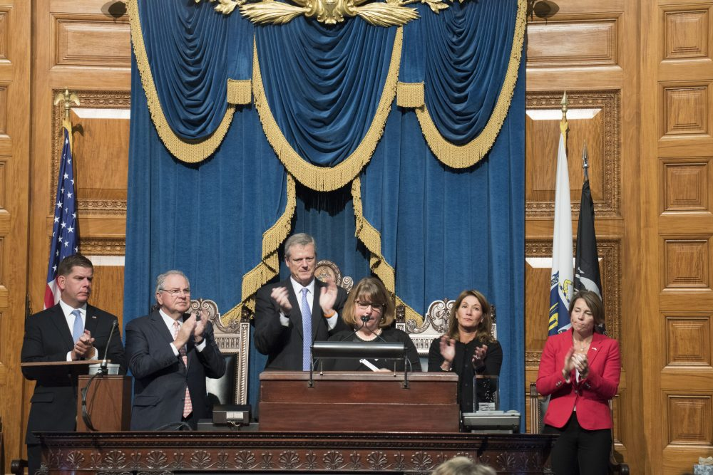 Michelle Dancy accepts the Madeline Amy Sweeney Award for Civilian Bravery on behalf of her late son, at the State House on Monday. (Courtesy of Kristina McComb for the Office of the Governor)