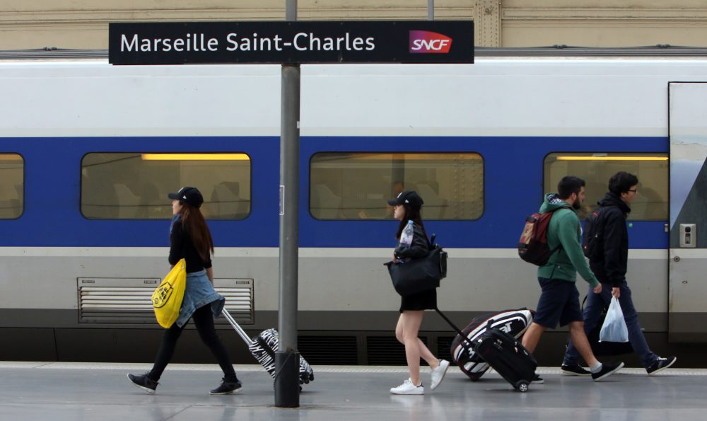 People walk on a platform to take a train, at the Saint-Charles railway station in Marseille, southern France, June, 1, 2016. (Claude Paris/AP)