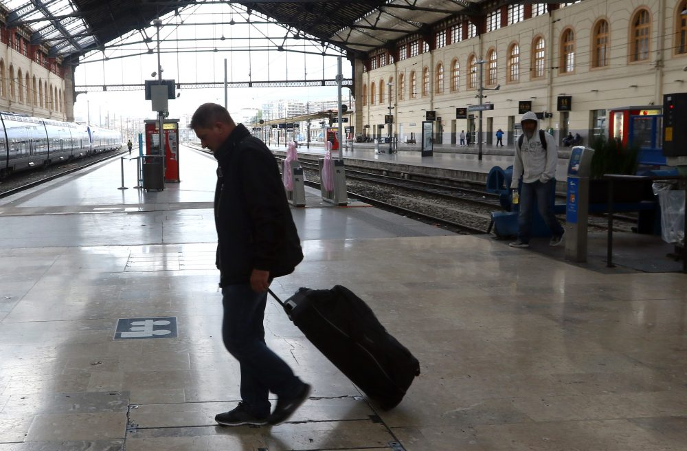A passenger walks past an empty platform at the Saint Charles train station, in Marseille. (Claude Paris/AP File Photo)