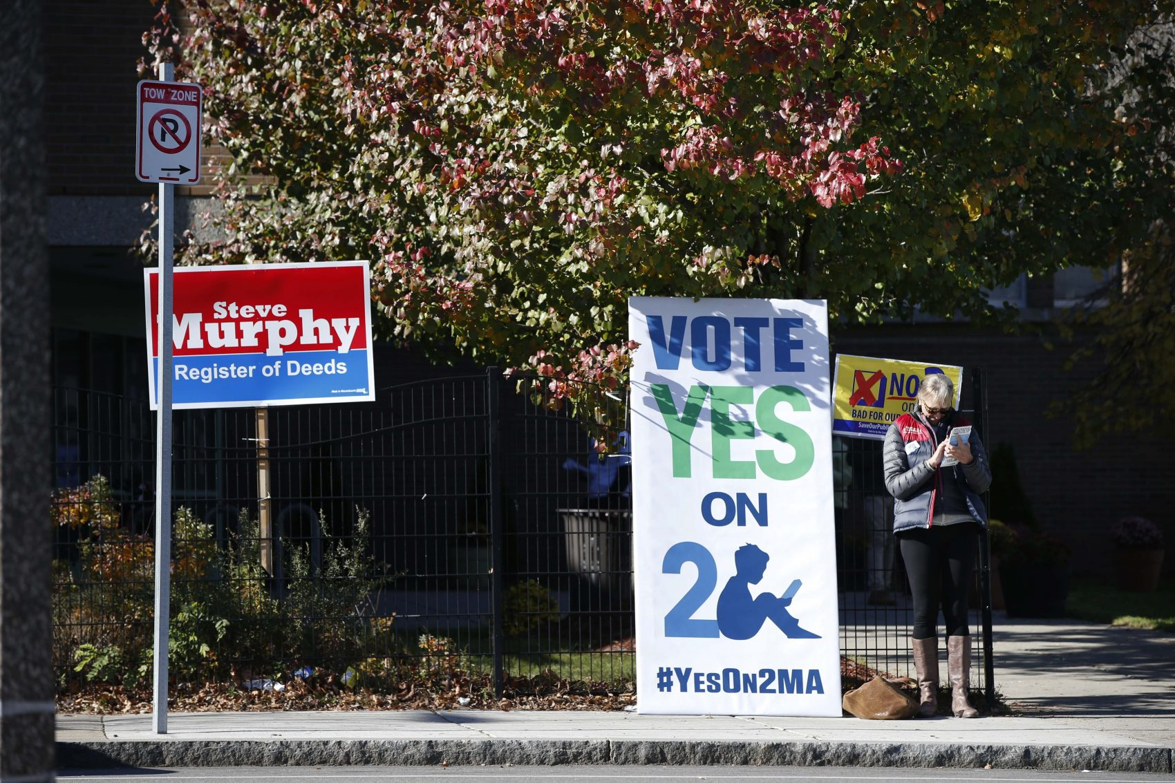 A sign promoting a ballot question to eliminate the cap on charter schools is seen outside a polling station in Dudley Square in Boston, Tuesday, Nov. 8, 2016. (Michael Dwyer/AP)