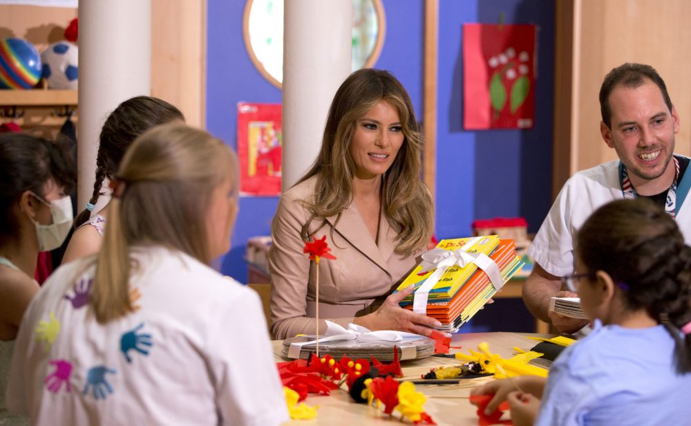 First Lady Melania Trump hands out Dr. Seuss books to patients at the Queen Fabiola Childrens Hospital in Brussels on Thursday, May 25, 2017. (Virginia Mayo/AP)