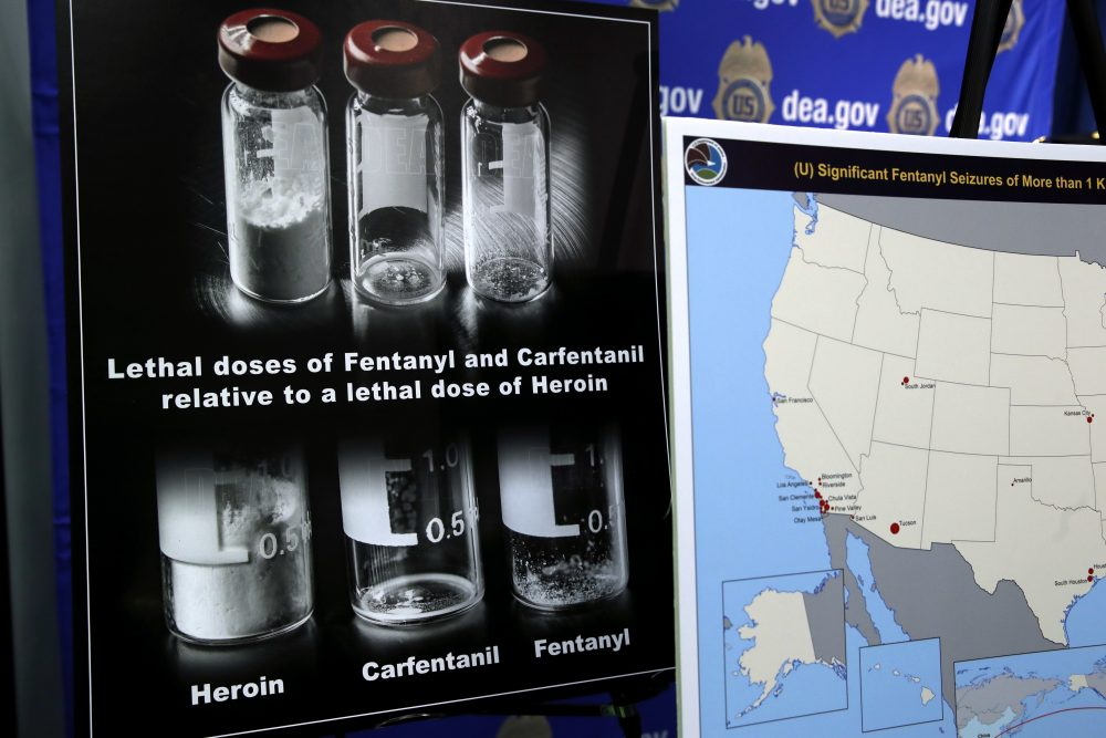 Posters comparing lethal amounts of heroin, fentanyl, and carfentanil, are on display during a news conference in Arlington, Virginia, in June. (Jacquelyn Martin/AP)