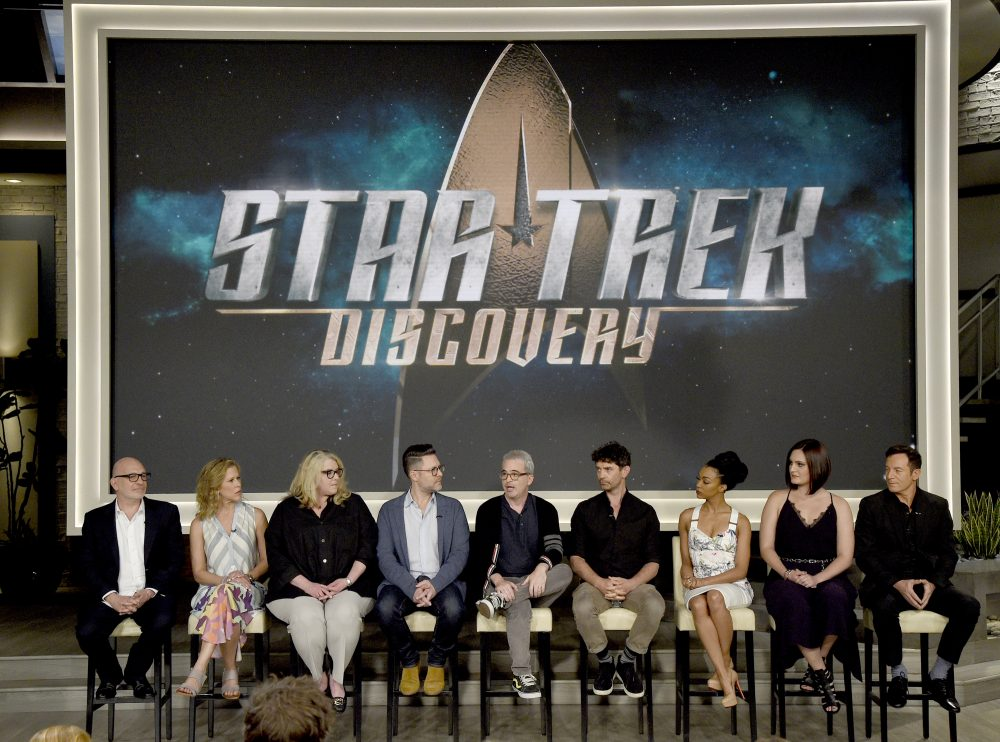 "Executive producers Akiva Goldsman, from left, Heather Kadin, Gretchen Berg, Aaron Harberts and Alex Kurtzman and actors James Frain, Sonequa Martin-Green, Mary Chieffo and Jason Isaacs participate in the ""Star: Trek Discovery"" panel during the CBS Television Critics Association Summer Press Tour at CBS Studio Center on Tuesday, Aug. 1, 2017, in Beverly Hills, Calif. (Photo by Chris Pizzello/Invision/AP)"