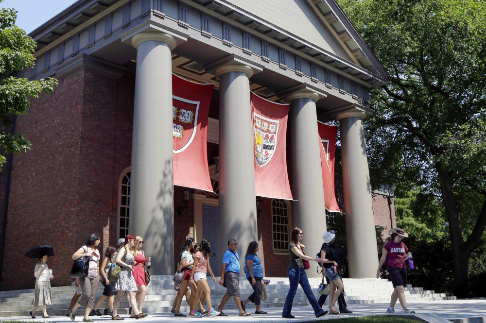 In this Aug. 30, 2012, file photo, a tour group walks through the campus of Harvard University. (Elise Amendola/AP)