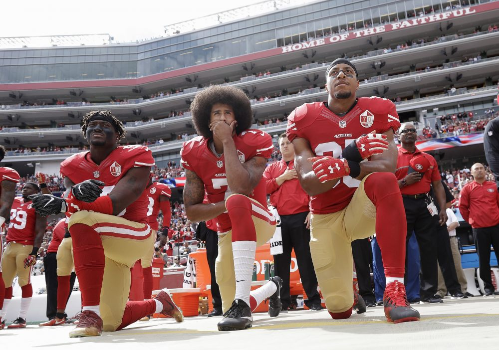 In this Oct. 2, 2016, file photo, from left, San Francisco 49ers Eli Harold, Colin Kaepernick, center, and Eric Reid kneel during the national anthem before an NFL football game against the Dallas Cowboys in Santa Clara, Calif. (Marcio Jose Sanchez/AP)