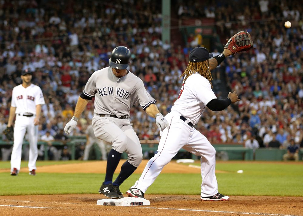 New York Yankees' Brett Gardner beats out an infield hit as Boston Red Sox first baseman Hanley Ramirez awaits the throw during the second inning of a baseball game at Fenway Park in Boston last month. (Winslow Townson/AP)