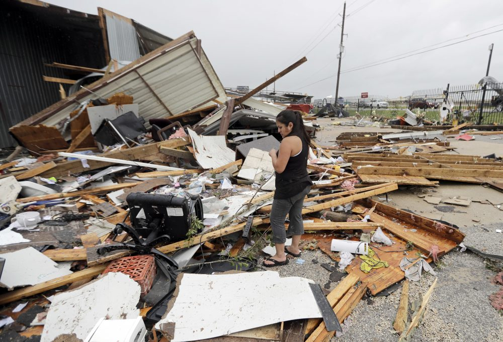 Jennifer Bryant looks over the debris from her family business destroyed by Hurricane Harvey Saturday, Aug. 26, 2017, in Katy, Texas. (David J. Phillip/AP)
