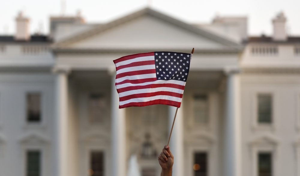 "A supporter of the Deferred Action for Childhood Arrivals, or DACA, waves a flag during a rally outside the White House, in Washington, Monday, Sept. 4, 2017. A plan President Donald Trump is expected to announce Tuesday for young immigrants brought to the country illegally as children was embraced by some top Republicans on Monday and denounced by others as the beginning of a ""civil war"" within the party. (AP Photo/Carolyn Kaster)"