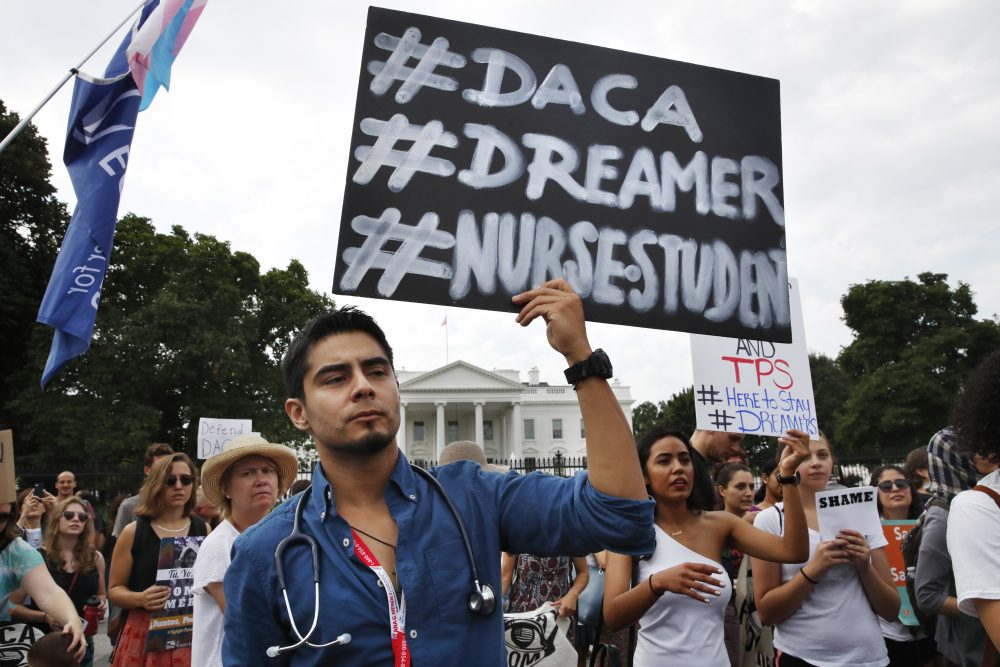 Carlos Esteban, 31, of Virginia, a nursing student and DACA recipient, rallies with others in support of the program outside of the White House Tuesday. (Jacquelyn Martin/AP)