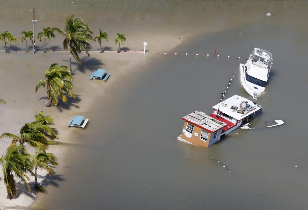 Boats are partially submerged in the wake of Hurricane Irma, Monday, Sept. 11, 2017, in Key Largo, Fla. (Wilfredo Lee/AP)